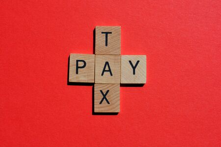 Tax and Pay, in wooden letters in crossword form isolated on red background Imagens