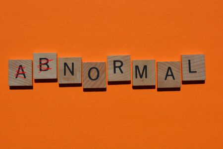 Abnormal, with ab crossed out in red, leaving the word normal