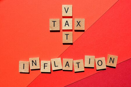 VAT and Tax in crossword form with the word Inflation on red background