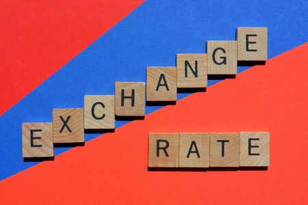 Exchange Rate, words in wooden alphabet letters on red and blue background