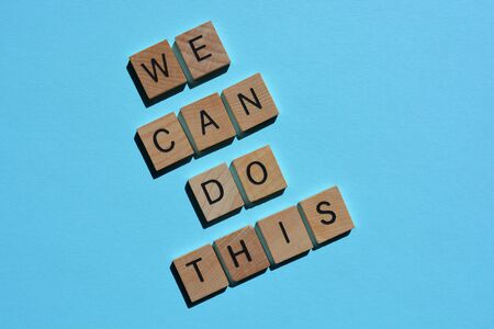 We Can Do This, words in 3d wooden alphabet letters isolated on blue background