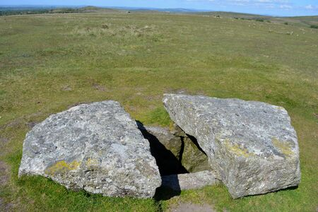 Stone lined burial chamber or cist, a prehistoric antiquity associated with the Neolithic to Middle Bronze Age settlement site, Merrivale, Dartmoor National Park, Devon, England