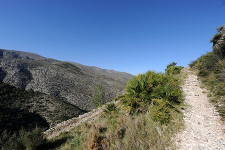 track in the mountains, an historic Mozarab trail near Benimaurell in the Vall de Laguart, Alicante Province, Spain Stock Photo