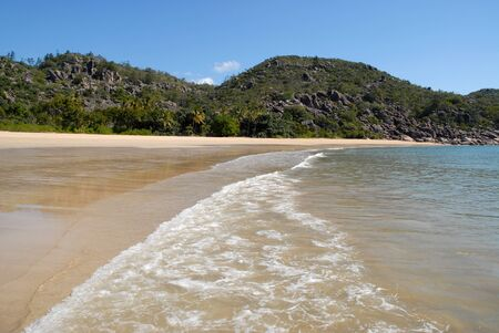 Beautiful palm fringed tropical beach view  at low tide, Radical Bay, Magnetic Island, Queensland, Australia Stock Photo