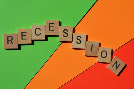 Recession, word in wooden alphabet letters isolated on green, orange and red background Stock Photo