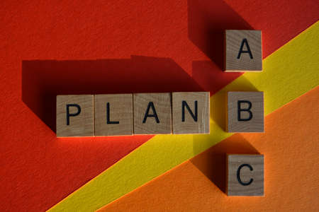 Plan A B C, words in wooden alphabet letters isolated on colourful background