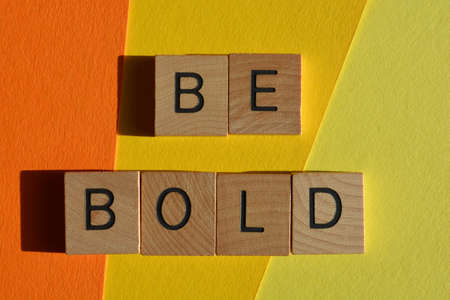 Be Bold, words in wooden alphabet letters isolated on colourful bckground Imagens