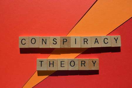 Conspiracy Theory, words in wooden alphabet letters isolated on bright red and orange background