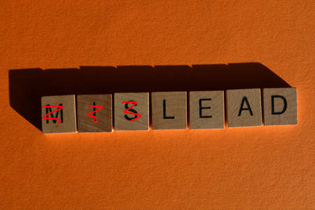 Mislead, in wooden alphabet letters, with prefix Mis crossed out, leaving the word Lead