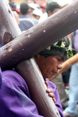 Quito, Ecuador, april 06, 2012 - penitent bearing a cross at the Good Friday procession