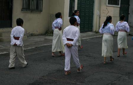 marcos: Quito, Ecuador - April 21, 2012 - Dancing children at the San Marcos procession