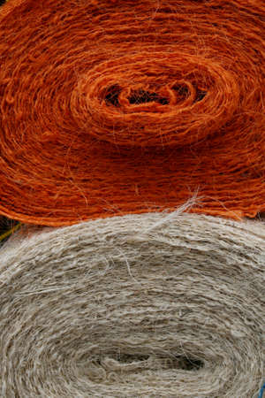 Close-up of two bales of jute in orange and white Stock Photo