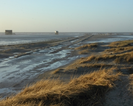 heir:  road to the sea, storm flood in st. peter-ording, germany