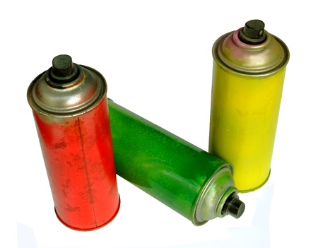 red,green and yellow  graffiti spray paint can photo