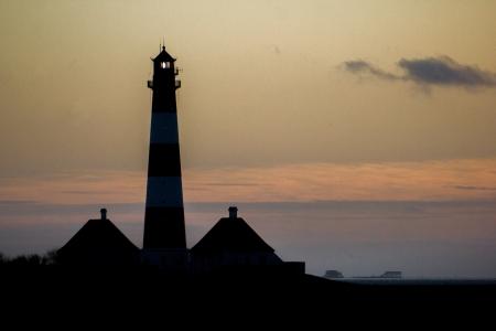 westerheversand lighthouse: Light House Westerhever at afternoon,against a sunset