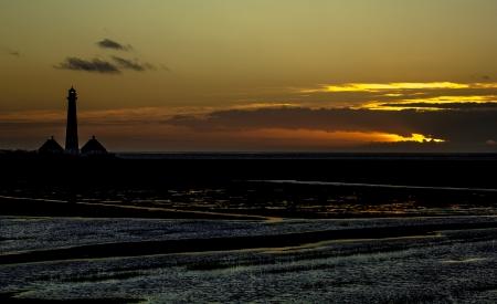 westerheversand: Light House Westerhever at afternoon,against a sunset