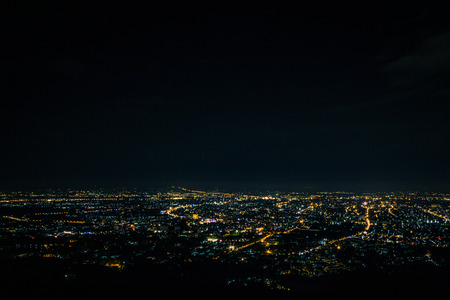 Night city scape at top view point of Chiang Mai, Thailand. Stock Photo