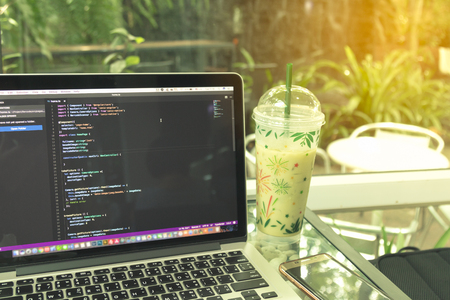 css: Developing programming and coding Applications with laptop. Website design, Mobile App, Cyber space concept.