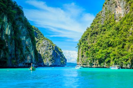 Boat in MAYA Bay Phi Phi Islands Andaman sea  Krabi Thailand. Фото со стока