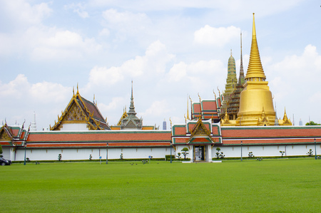 Wat Phra Kaew temple with green grass in thailand