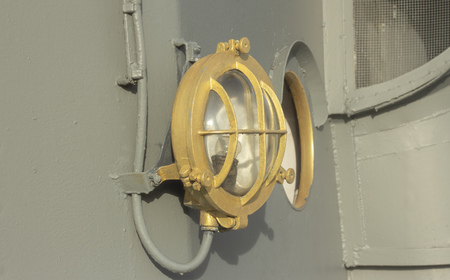 Old Vintage Lamp on Ship Deck Wall Surrounded on Navy Ship