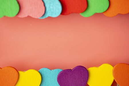 two rows Beauty Colorful mini hearts with pink background and copy space Banco de Imagens