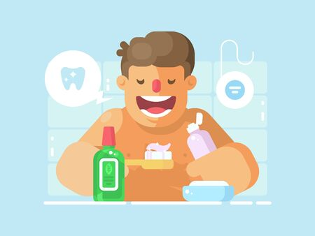 Young guy brushing teeth with whitening paste