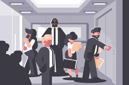 Businessmen and businesswoman waiting for elevator Standard-Bild