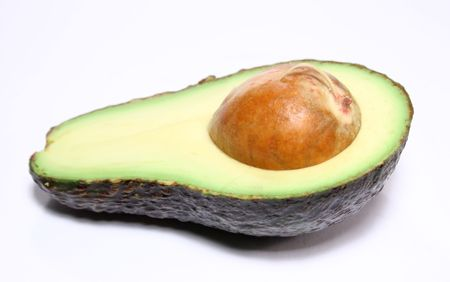 Cross sectioned avocado Stock Photo
