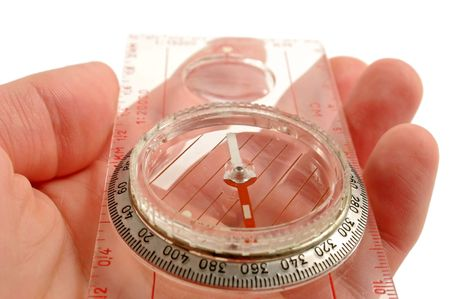 corrections: Hand holding compass