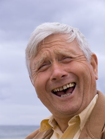 chuckle: Elderly man laughing