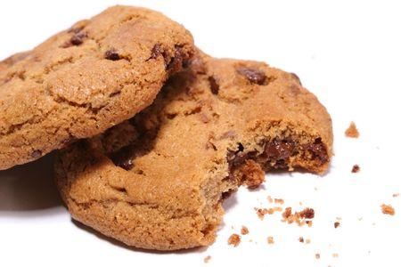 Half eaten chocolate chip cookie Imagens