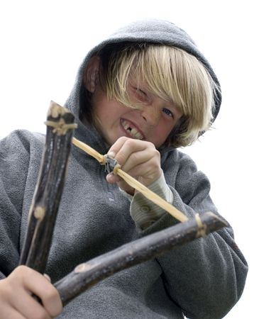 trouble free: Mischievous boy with slingshot
