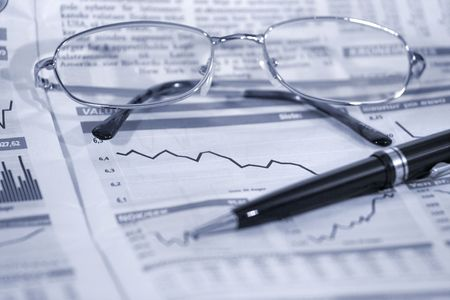 financial newspaper: Glasses and pen on financial newspaper Stock Photo