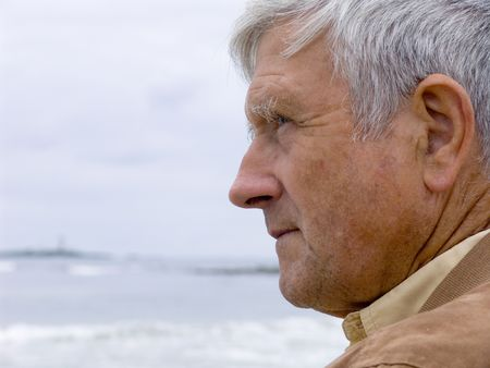 ponder: Elderly man looking out over the ocean