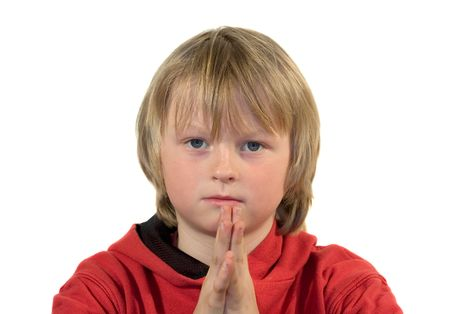 pleading: Boy with pleading expression and folded hands Stock Photo