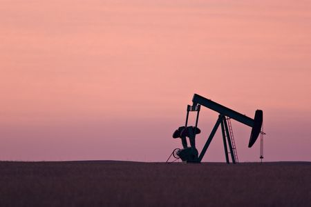 Pumpjack (for oil) at dawn photo