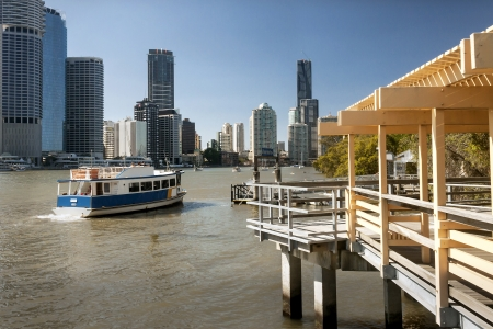 Ferry on river with Brisbane city behind, Australia Stock Photo