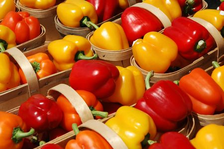 bell peppers: Red, orange and yellow bell peppers in farmer baskets Stock Photo
