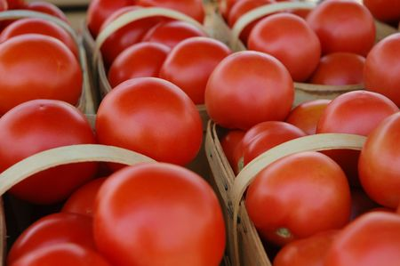 tons: Baskets with tons of red tomatoes