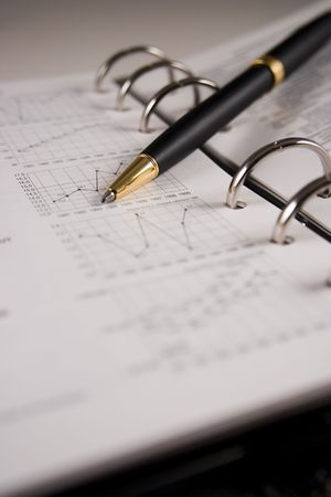 Stock chart with a pen Stock Photo - 2338564