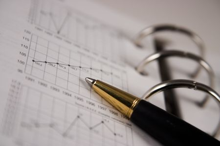 Stock chart with a pen Stock Photo - 2338562
