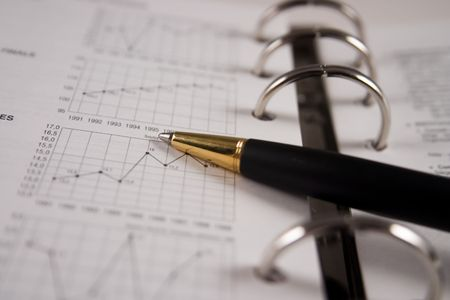 Stock chart with a pen Stock Photo - 2338561