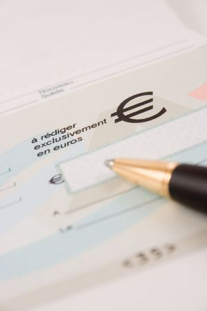 blank check: Close up of a pen and blank check Stock Photo