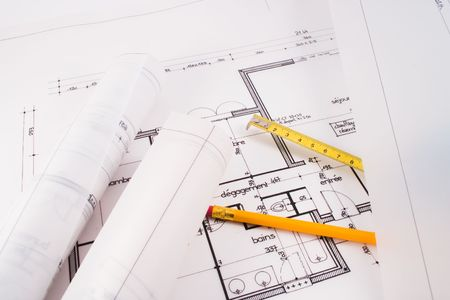 bluelines: Plans of a  designed by an architect with a yellow pencil and an instrument of measurement