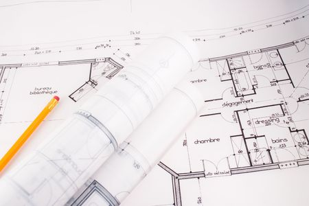 bluelines: Plans of a  designed by an architect with a yellow pencil