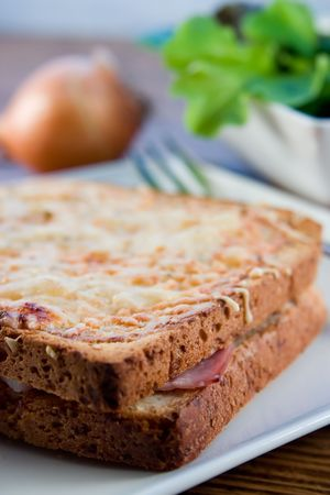 toasted sandwich: Croque Monsieur, toasted sandwich with cheese and ham with a salad Stock Photo