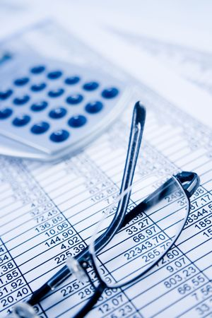 scrutiny: A calculator, pen, and financial statement. Stock Photo