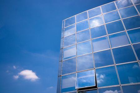 Clouds reflected in  building windows photo