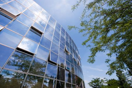 office building exterior: Trees reflected in  building windows
